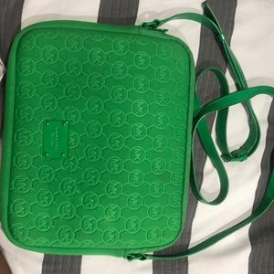 MK tablet case with crossbody strap.
